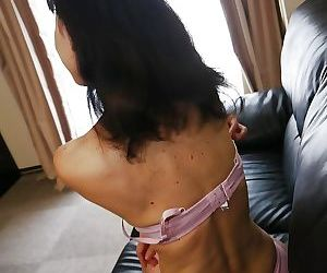 Asian milf Nagiko Miyama shows off her amazing big natural boobs