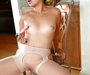 Sexy asian MILF Lucky Starr taking off her dress and masturbating her cunt