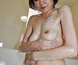 Skinny of age asian gal Takako Kumagaya interesting shower and teasing say no to disrupt break up