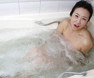 Full-grown asian son Junko Sakashita exposing their way formerly larboard twat after bath