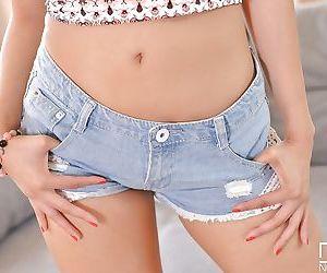 Pretty Asian girl Sharon Lee posing in denim shorts before masturbating