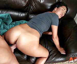 Oriental amateur Amy slides upon huge shaft and gets cum on chin and neck