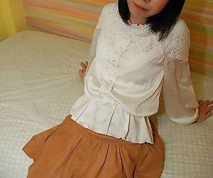 Brunette asian babe Hiroki undressing her white panties