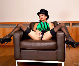 Asian model Kina Kai dons a top hat to show her twat in black stockings