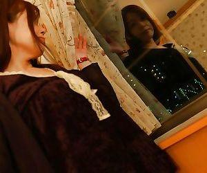 Asian MILF with hairy gash Eiko Sakai undressing and spreading her legs
