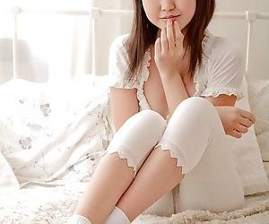 Slippy asian teen lowering her pants and teasing her soft honey pot