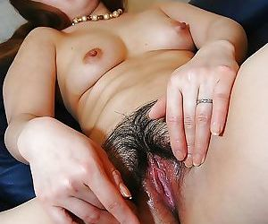 Asian MILF Ayako Sakuma undressing with the addition of showcasing will not hear of succulent cunt in wine bar