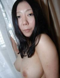 Well-stacked eastern lassie undressing and exposing her wet cage of love in close up