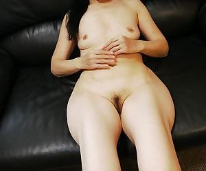 Middle-aged Asian woman Takako Numai poses in her nice pantyhose