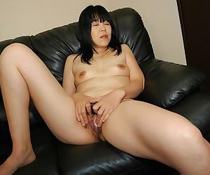 Asian MILF with chubby curves strips down and has some pussy vibing fun