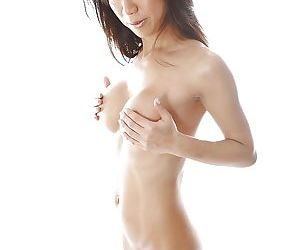 Asian MILF Tia Ling slipping off her bikini and exposing her petite curves
