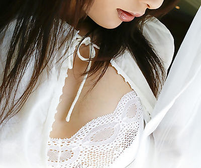Adorable asian babe with nice tits and hairy cunt stripping off her clothes