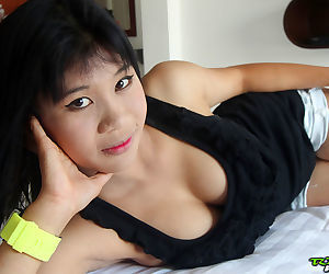 Thai sex worker gives up her firm tits and bald pussy to a Farang