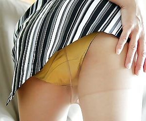Asian gal Kimie Kuwata undressing and exposing her goods in close up