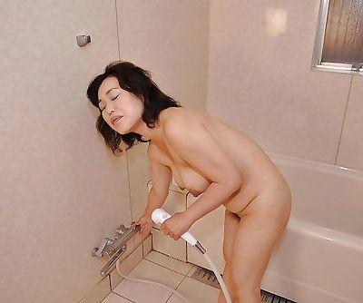 Fuckable asian MILF with nice tits Junko Morikawa taking shower