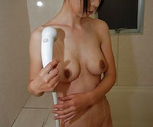 Sassy japanese MILF taking shower and rubbing her soapy curves
