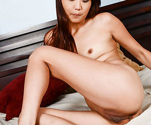 Shaved pussy and tiny tits of an amateur Asian Miko Dali shown in close up