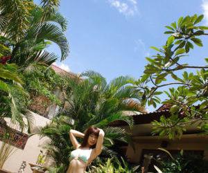 Cute asian babe Hikari Hino slipping off her bikini top outdoor
