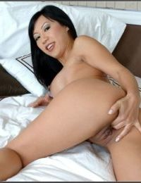 Shapely asian mature Tia Ling strips big breasts and finger fucks pussy