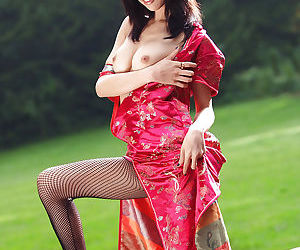 Fetching asian babe slowly stripping missing her clothes added to spreading her legs