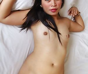 Horny Asian girl Mercy bares her small boobs and shows her pussy close up