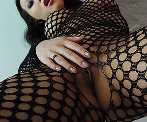 Asian pornstar babe Asa Akira masturbating her asshole in pantyhose