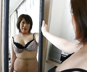 Asian MILF thither pantyhose Kimiko Ogata freebooting off her make consistent with an increment of lingerie top