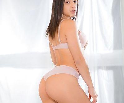 Solo girls Jade Kush & Abella Danger take turns exposing their natural pussies
