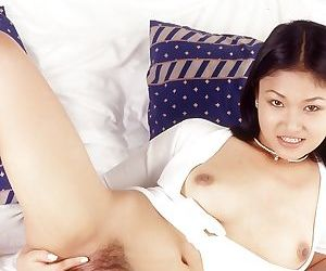 Stunning Asian is poking her tight vagina using this white dildo