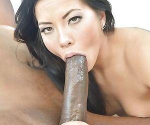 Brunette Asian pornstar Morgan Lee giving massive black cock interracial bj