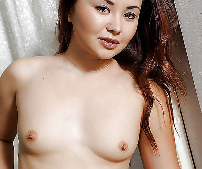 Pretty Asian first timer Kita Zen flashing small Oriental tits