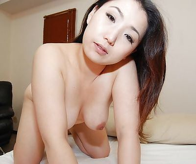 Asian MILF Kaho Itou stripping and playing with her sex toys