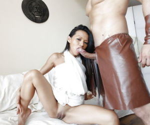 Petite Asian whore Lady Mai giving a fully clothed blowjob
