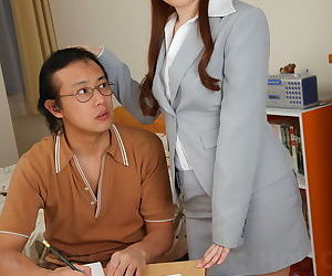 Pulchritudinous Japanese teacher models fully clothed for her admiring partisan