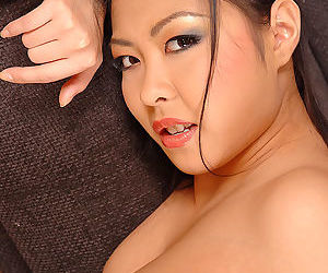Asian solo girl with nice ass strips off panties for masturbation session