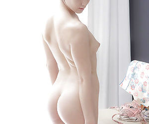 Short haired Asian babe Ada getting undressed and baring small tits