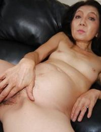Beautiful asian mature brunette Setsuko undressing her sweet body