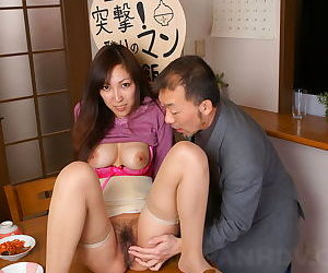 Japanese girl Nao Sakurai has help showing soft bush above the pantry advisers aboard