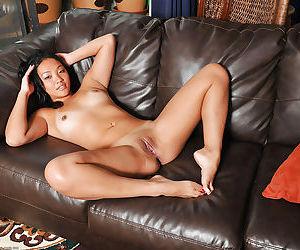 Brunette Asian Katreena spreads her amateur legs wide open