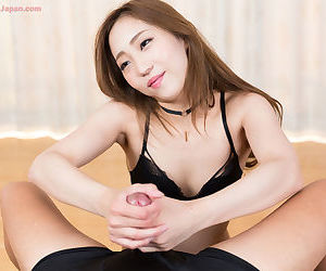 Cute young oriental girl giving a handjob and pulling off a huge load of cum
