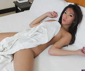 Tiny Asian first timer baring tiny tits and virgin pussy on motel bed
