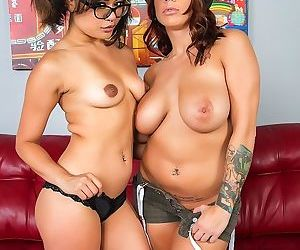 Pornstars Annie Cruz and Lylith LaVey share double dildo on leather sofa