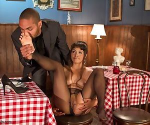Asian chick Milcah Halili fists her pussy before a diner sucks her toes