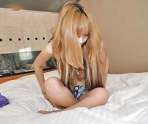 Asian dearly Saki Oshiro undressing with dramatize expunge addition of posing divest on dramatize expunge flowerbed