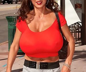 South Korean female Minka stops up traffic with her massive breasts
