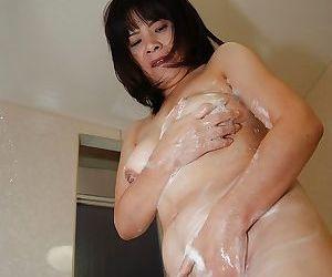 Nasty asian brunette Yumiko washing her tight mature pussy