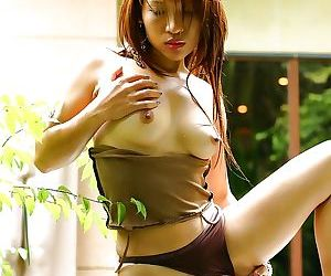 Hot exotic looking Thai babe baring her perfectly formed natural tits