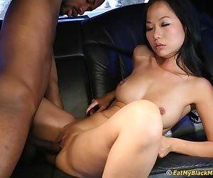 Asian slut has some interracial cock sucking and fucking fun in the car