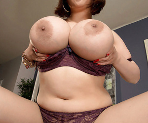 Asian MILF Tigerr Benson unleashing huge fake tits and pierced pussy