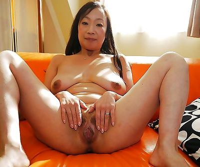 Aged Asian woman Takako Miyai stripping naked and spreading hairy twat